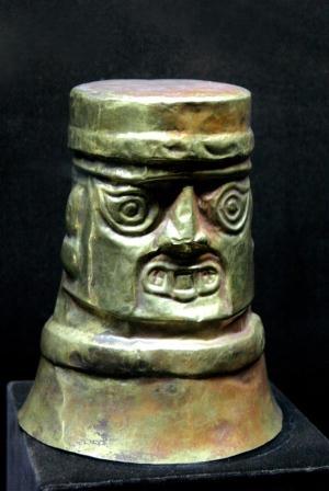 carved figures in metal