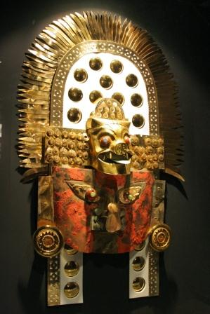 a mask with a crown with hundreds of solid-gold plates